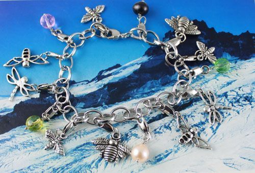 SC126 Handmade silver chain charm bracelet - Dragonfly Bee insect faux pearl and Crystal Charms. Normally retails for around $25 each - my selling price (including postage within Australia) is $15.00 each... Please feel free to contact me if your require price for postage overseas…
