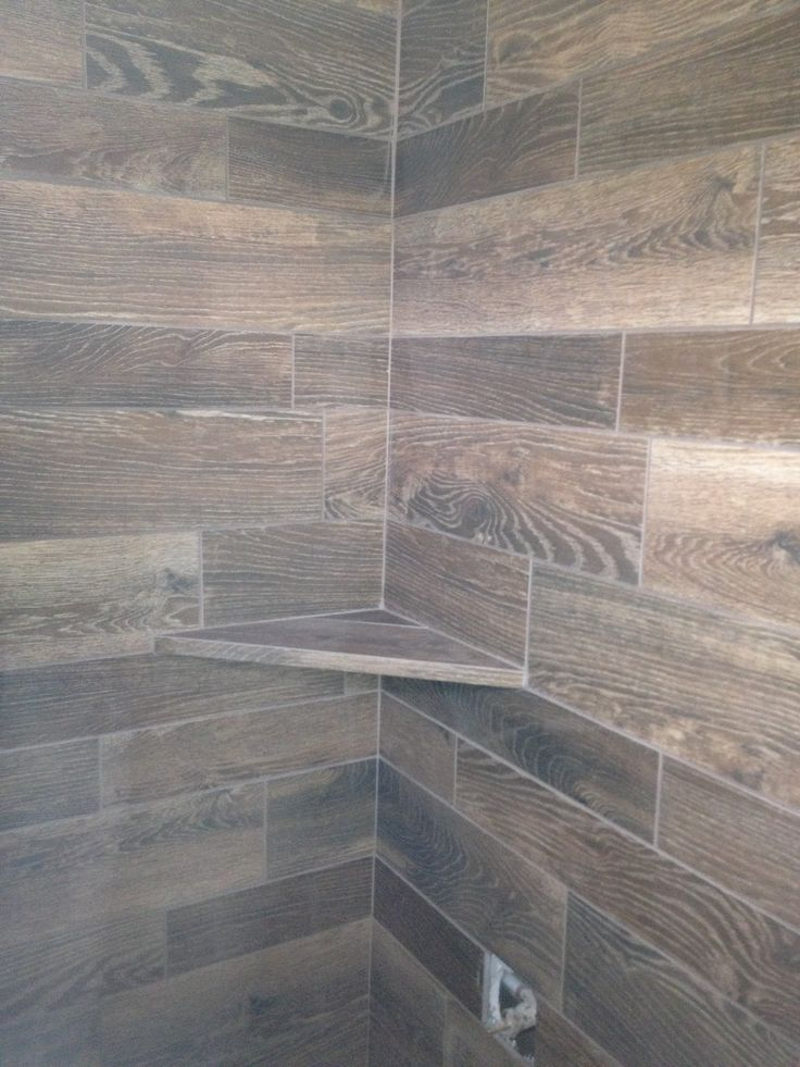 Wood tile walls and shelf in shower bathrooms for Grey wood floor bathroom