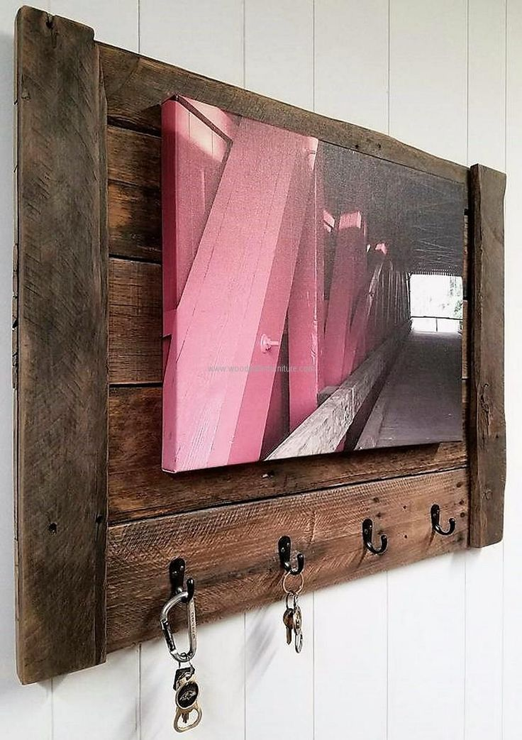 See the reclaimed wood pallet key holder; it is looking nice as an image is pinned to it. It doesn't look weird without the image, so pinning the image is optional. Not only the keys can be hanged on it, other products like the coat can also be hanged on it.