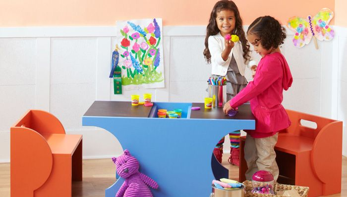 Brighten up a child's room with this versatile playset. Kids play on the tabletop - and you hide the art supplies and store the benches when they're done!