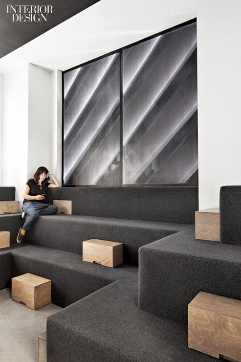 Wool carpet covers built-in seating in a lounge. Photography by Floto + Warner…