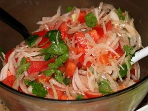 Ensalada de la Chilena! Tomato, onion, cilantro, oil, and of course lots of salt. You wouldn't think there could be much variation recipe to recipe, but no one has ever made it as good as Hermana Rut in Mulchén! Maybe it was because she added ají (hot green chiles)!