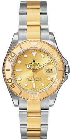 Rolex Yachtmaster Champagne Dial Oyster Bracelet Two Tone Unisex Watch. 18kt yellow gold case with a 18kt yellow gold and stainless steel oyster bracelet. Unidirectional rotating bezel. Gold dial with luminous hands and luminous dots hour markers. Minute markers around the outer rim. Luminescent hands and dial markers.  $9307.00  #Rolex #LuxuryWatches