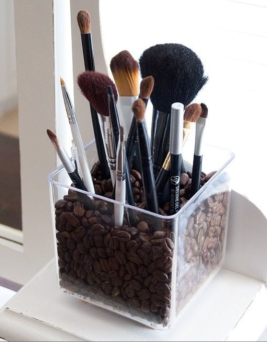 Here's one way to wake you up in the morning! Store your brushes in coffee beans and use the scent of java to give you that extra jolt!