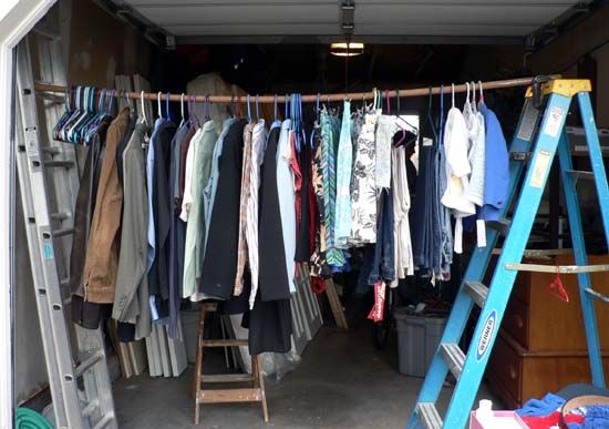 Hanging Clothes At Garage Sale Hang Up Your Clothes