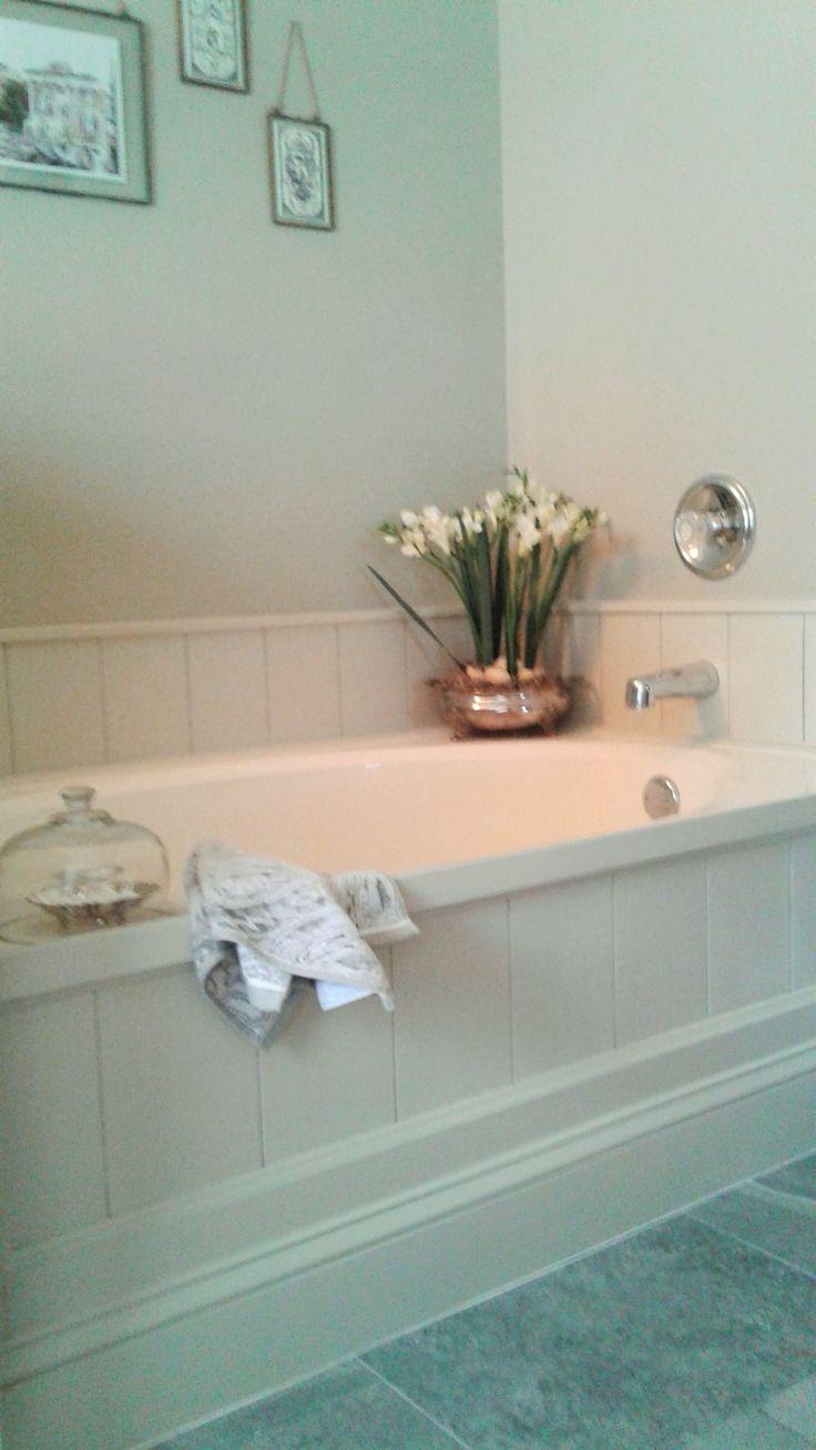 DIY tub surround using peel and stick vinyl planks to