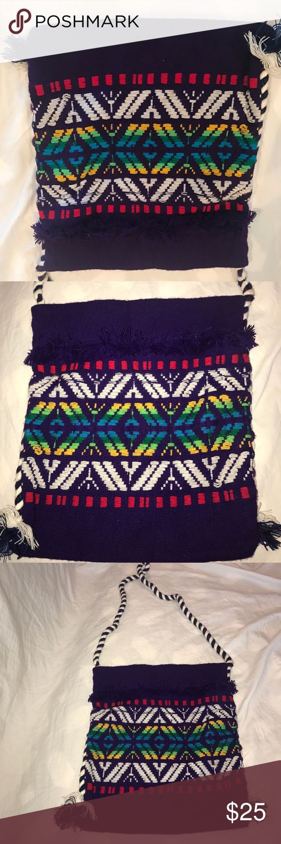 Vintage Hippie Aztec Indian Tote Bag Embroidered colorful bag on a purple backdrop. It has an open pocket. It measures about 13 inches in height, 11 inches in length, and has a 19 inch strap drop. Bags Totes
