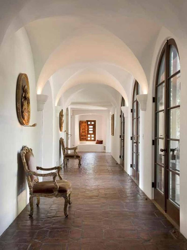 Awesome Hallway Decorating Inspiration With Cuved White Ceiling With White Wall And Dark Brown Floor With Brown Armchairs Along With Glass Doors With Curved Black Frames - Use J/K to navigate to previous and next images