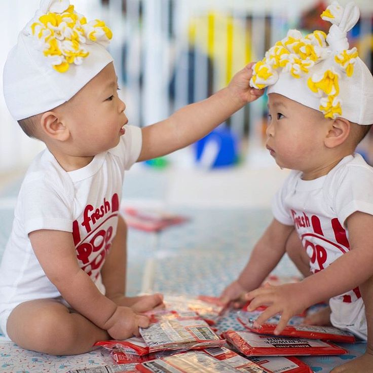 Twin babies in popcorn costumes! How cute! Love the popcorn details on the baby costume.