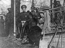 Tsarevich Alexei in his army uniform with sister Tatiana in 1917.