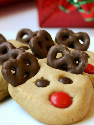 Peanut Butter Reindeer Cookies -   Shape dough into balls and gently pinch at the bottom before baking; then immediately press pretzels and candy into the cookies when removed from the oven