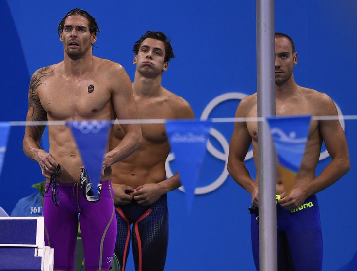 France's Camille Lacourt (L), Jeremy Stravius (R) and Theo Bussiere react during the Men's 4x100m Medley Relay heat 2 during the swimming event at the Rio 2016 Olympic Games at the Olympic Aquatics Stadium in Rio de Janeiro on August 12, 2016.   / AFP / GABRIEL BOUYS