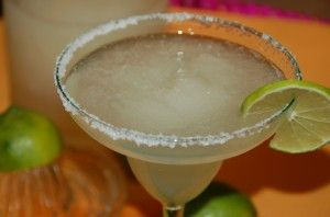 Question: How to make frozen margaritas for a party without manning a blender for a whole party?? Answer: Frozen Margarita Punch.
