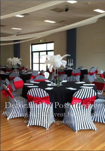 Red satin sashes, black and white striped lycra chair covers, black table cloths, feathered table centres all for hire. Australia wide. Visit www.poshdesigns.com.au for more photos and info, or email lisa@poshdesigns.com.au for pricing packages
