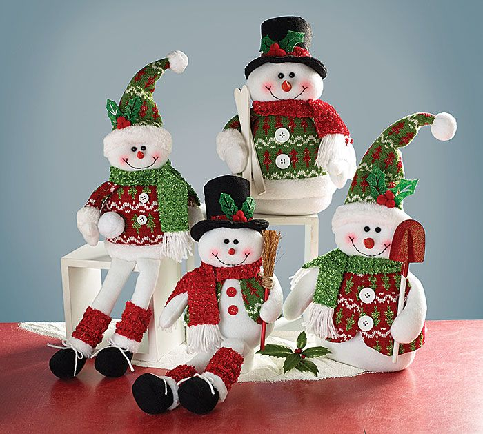 """#burtonandburton Plush snowmen assortment of shelf sitters and without feet. Snowmen without feet include: snowman with black top hat holding skis; snowman with green skit hat holding shovel. Shelf sitter snowmen include: snowman with black top hat holding broom; snowman with green knit hat holding snowball.<br><br>Without Feet: 12 1/2""""H X 9""""W X 7""""D.<br>Shelf sitters: 10""""H X 6""""W X 3""""D and legs 8""""Long.<br>2 varied sets of 2."""
