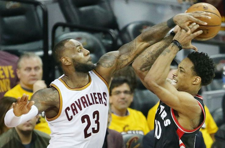 Cleveland Cavaliers forward LeBron James (L) blocks the shot attempt of Toronto Raptors guard DeMar DeRozan in the third quarter during game 1 of the Eastern Conference semifinals, May 1, 2017, at Quicken Loans Arena.