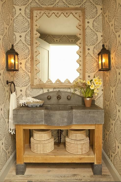 Rustic powder room features a wood and concrete wa…