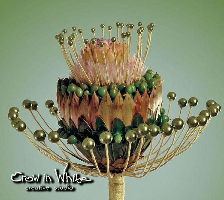 Wedding bouquet. Hypericum, beads and protea
