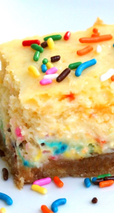 Cake Batter Cheesecake Bars... Used funfettit instead of yellow cake mix and added extra sprinkles of course. Mike loved it!!