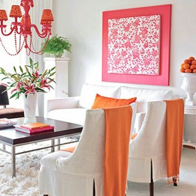 fabric wall art - extend the impact of the piece by backing it with a larger single color canvas