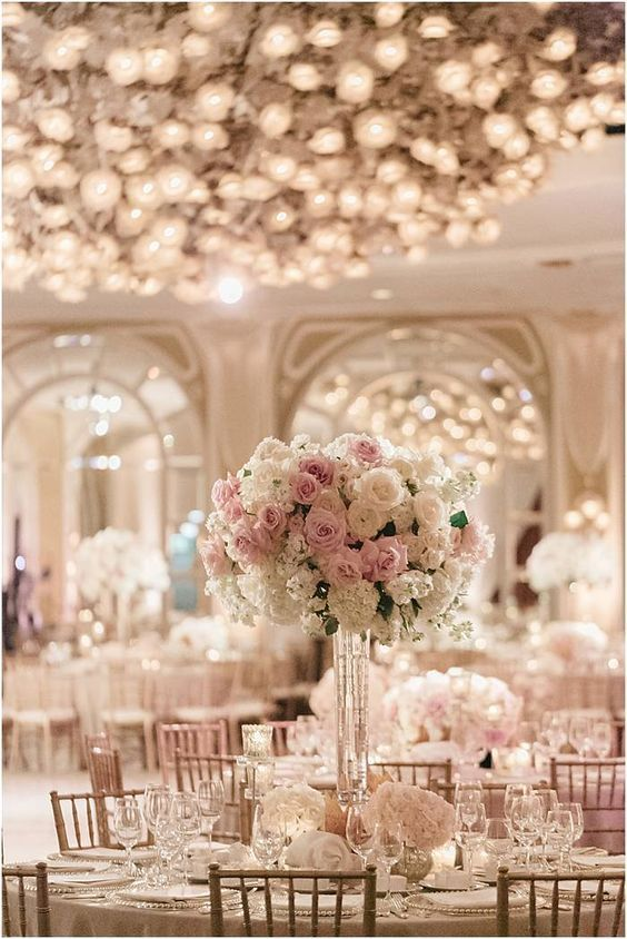 Photographer: Jana Williams; Glamorous white indoor wedding reception with white and pink flower centerpiece;
