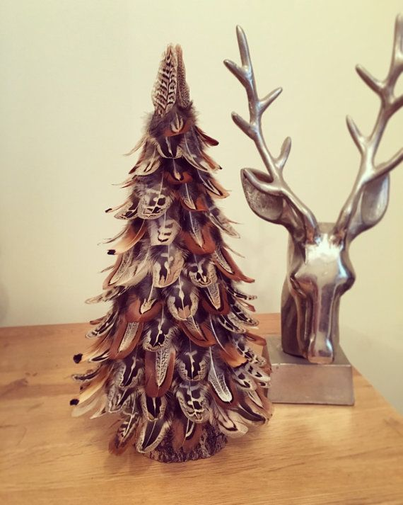 Handmade Pheasant feather tree with a willow log base. Beautiful unique Christmas or all year decoration that wondefully symbolises the shape of a tree and its leaves. Approx Height: 13 inches Please note that each tree is handmade and unique therefore the feathers may vary from shown.