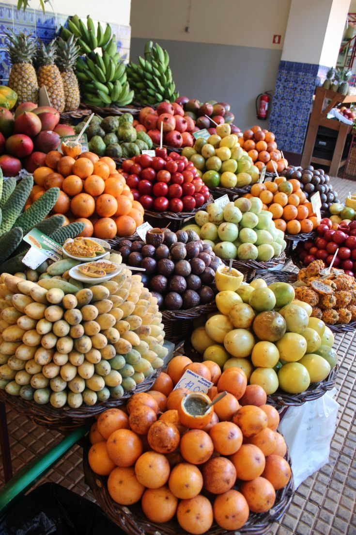Madeira - Funchal. Tropical fruits of all kinds piled high in the Mercado Lavradores.