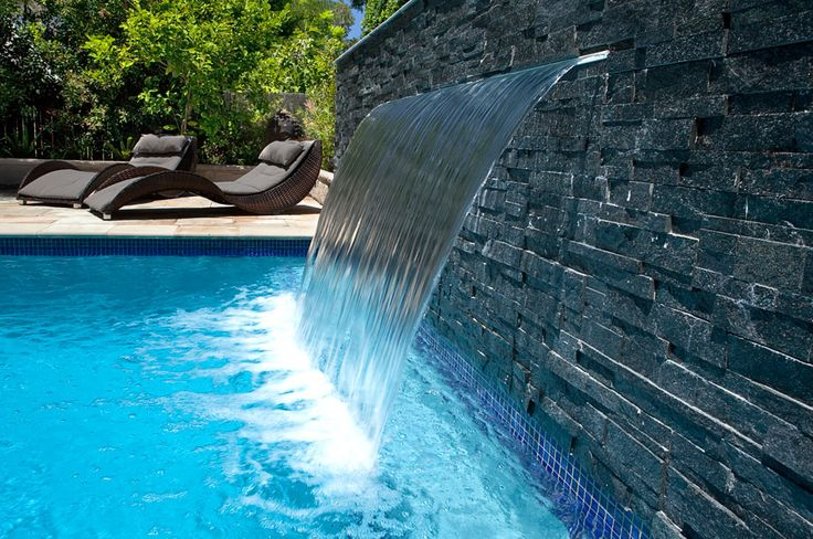 This swimming pool design has a Water Feature and Sheer Descent waterfall, natural stone pavers, spa jets and is laid throughout the entertainment area ...