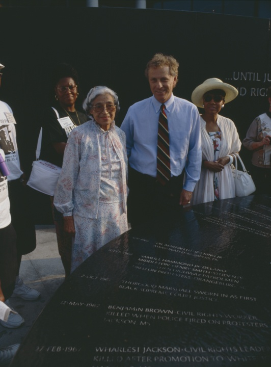 Q57356 - Rosa Parks and Morris Dees beside the Civil Rights Memorial at the Southern Poverty Law Center in Montgomery, Alabama. (ADAH)