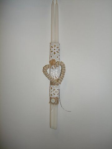 Handmade Easter candle decorated with item made by beads.