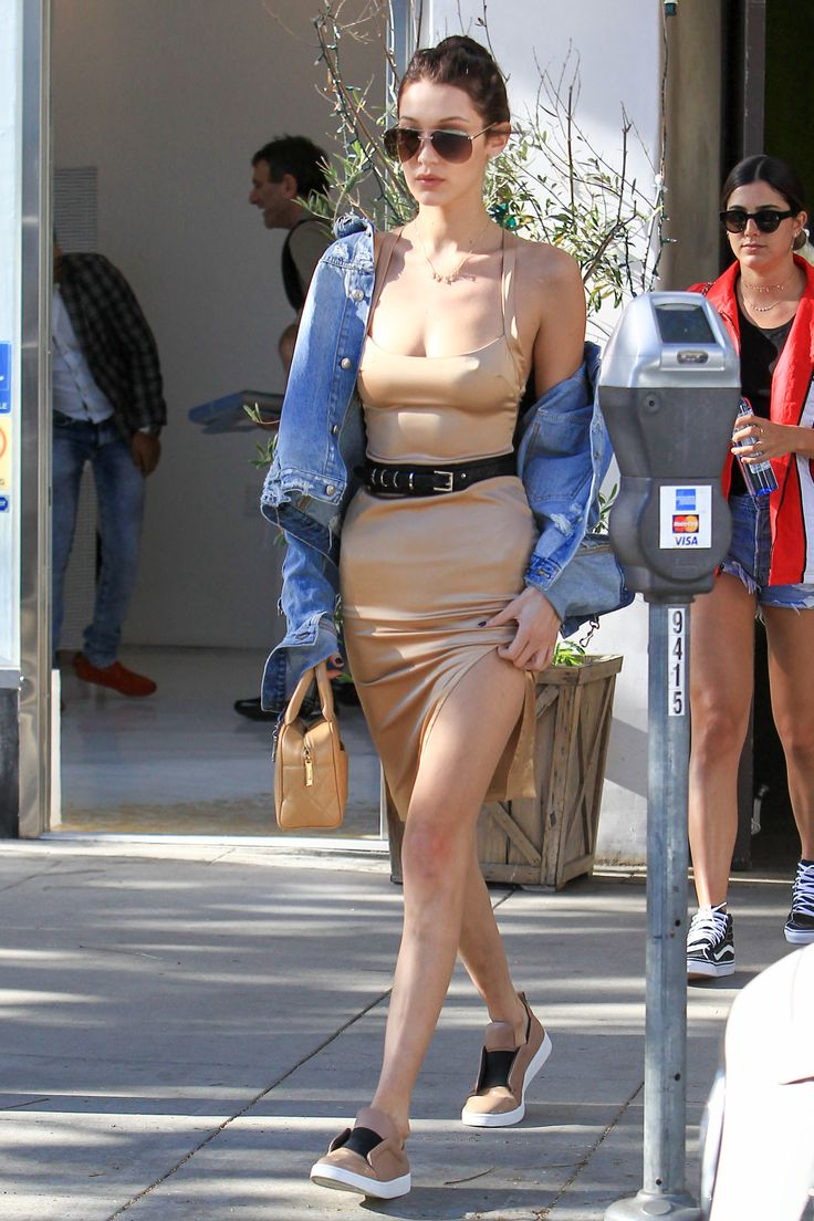 Best dressed this week: Bella Hadid was spotted in Los Angeles wearing a nude dress, nude trainers and a denim jacket.