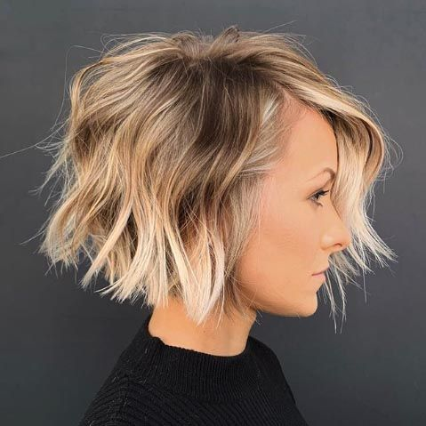 15 Volume-Boosting Haircuts for 2020 Even Dolly Parton Would Approve Of | Let's have a moment of silence for all the flat strands sacrificed to make this ultra-volumized bob. A stacked bob is the perfect way to pump up height and body on short hair. #beautytips #southernliving #hair #hairstyle