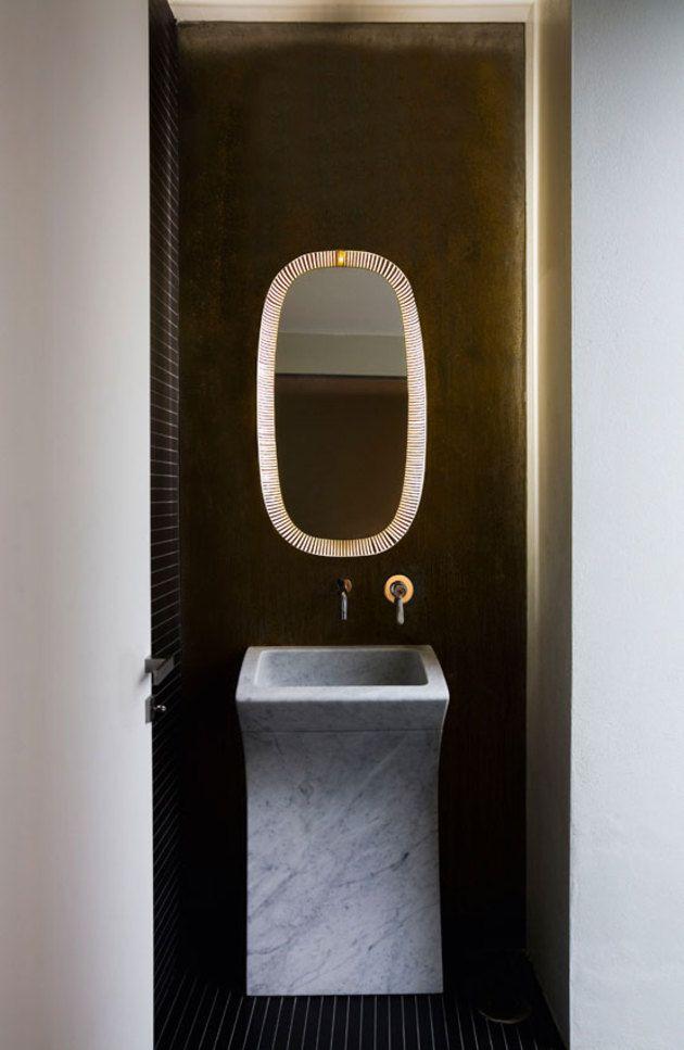 Dark but fun cloakroom. Love the mirror.