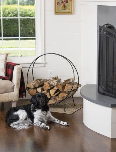 I need a fireplace someday and this adorable log holder....and maybe the dog too! :)