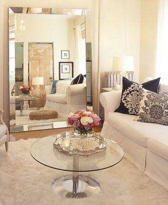 Flavia: House & Home - Beaded beveled floor mirror, glass top coffee table, slipcovered white ...