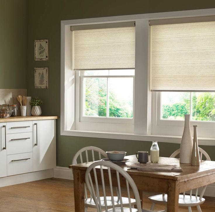 Country style vintage kitchens are as popular as ever, get the look with olive walls, wooden work tops and classic pieces of furniture, finish with simple, but luxurious neutral roller blinds.