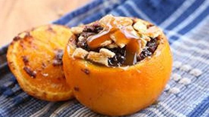 Fudgy brownie cakes baked inside an orange -- in the campfire! Camping desserts don't get any better...