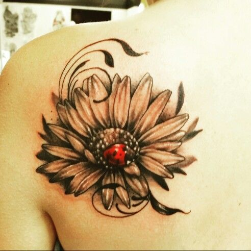 My ladybug ink.  3D style bug on a beautifully designed daisy.  Comfortable where she is with the freedom to fly.