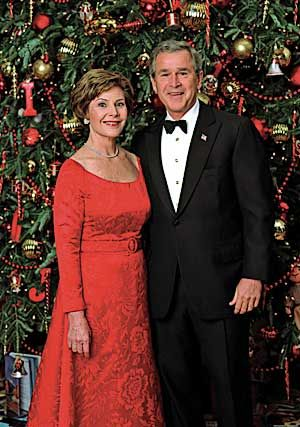 The President and First Lady In front of the White House Christmas Tree in the Blue Room, December 7, 2003.