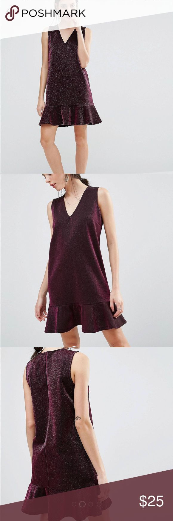 ASOS Petite Metallic dress with Hem ASOS Petite, brand new, never worn. - US 4 - burgandy/dark red, with shimmering - hem at the end of thendress - material is flexible  * sizing accuracy can check ASOS sizing guide online. * clothing's colouring maybe different due to lighting. * all packaging will be photographed, to guarantee items deliver as described, what you buy is what you get! ASOS Petite Dresses