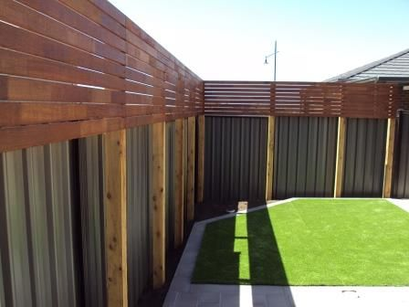 Hide the ugly colourbond fence with timber screening panels
