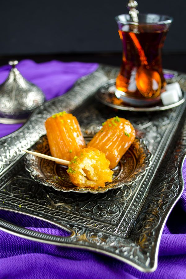 An amazing Turkish dessert tulumba. Fried dough soaked in sweet syrup. A little crunchy outside, quite juicy inside. These are heavenly mini delights! | giverecipe.com | #turkish #dessert #tulumba