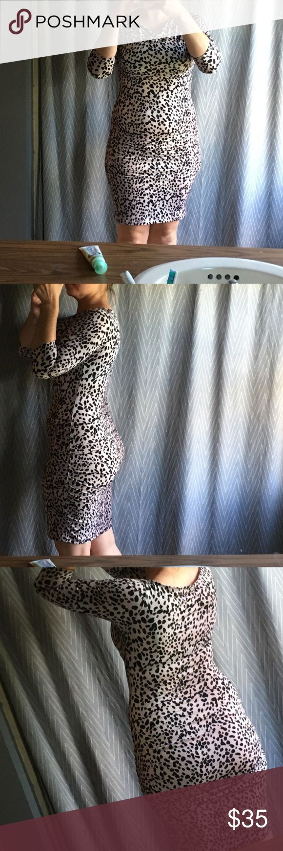 Cheetah print dress 3/4 length long sleeve dress. So comfortable, hugs the body in all the right places. Size is XS and I usually wear a s/m. Perfect for a night out with the girls😉 J. Lopez Dresses Mini