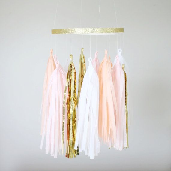 Our peach, blush, white and gold tassel mobile is the perfect addition to your space. Be it a statement chandelier piece at your next party or