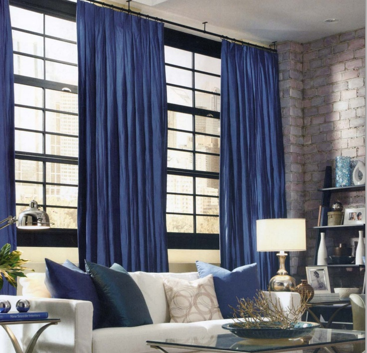 A Modern Loft With Ceiling Mounted Blue Shantung Silk Curtains And Hardware