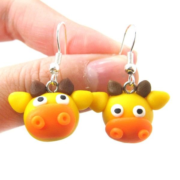 - Details - Sizing - Shipping A pair of super cute giraffe shaped dangle earrings made from polymer clay! If you love giraffes, check out our collection of giraffe themed animal jewelry and products i