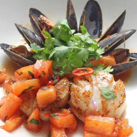 This photo of #PEI #mussels and #scallops in Blood #Orange #salsa made by Curious Thymes Bistro, Events & Catering in Sudbury, Ontario is just begging to be shared ;-)! To learn more about PEI Flavours visit www.peiflavours.ca