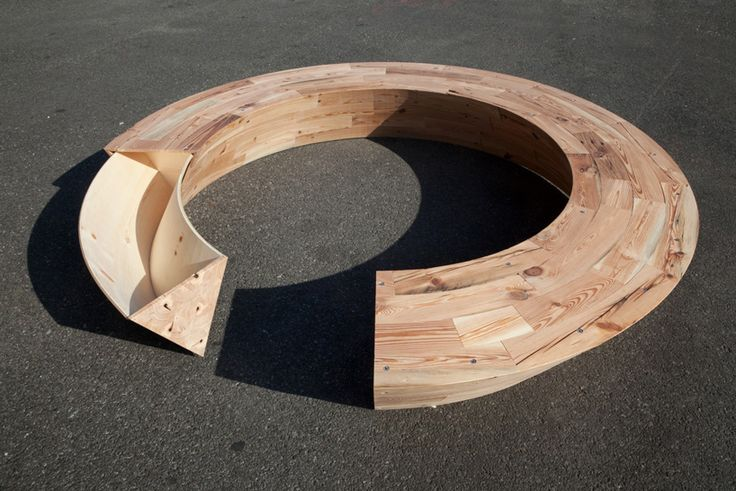 curved bench with hidden storage & unusual support base... by Louis Lim