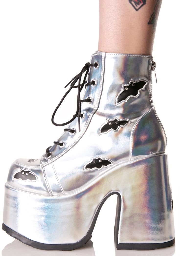 Demonia Holographic Megabat Platform Boots are harmless until the night becomes black and the moon full and bright… These gnarly boots feature a crazy bright holographic vegan leather construction, ultra thick platform sole 'N heel, black bat cutouts all over, lace-ups, and zip back closure.
