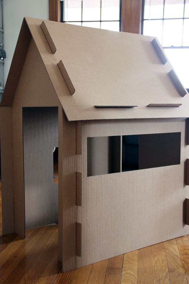 What a great DIY cardboard playhouse!  After our movers leave and we are alone in the house we will have to make this!